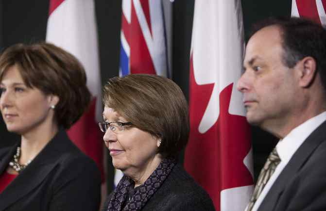 British Columbia Premier Christy Clark (left), Attorney General Shirley Bond (center) and Richard Rosenthal (right), the provincial chief civilian director for police oversight.