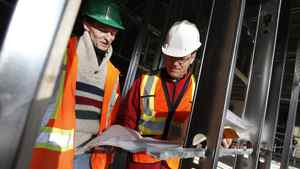 John Baker (white hard hat), general manager for Inner City Renovation (ICR) looks over some plans with site supervisor Larry Laberge as a crew renovates an old bank into a credit union in Winnipeg's North End Thursday, October 20, 2011. Inner City Renovation (ICR) is a social enterprise in Winnipeg which does construction work and employs people with criminal records, former gang members, etcetera. (John Woods for the Globe and Mail)
