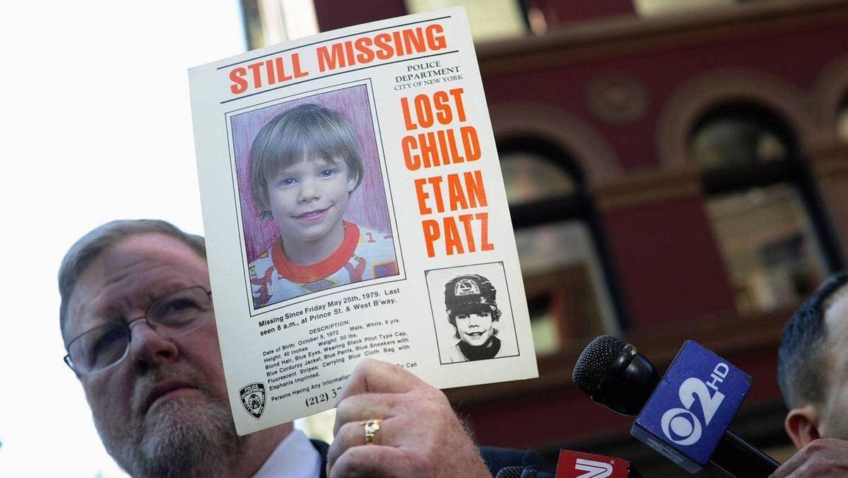 New York Police Department spokesman Paul Brown holds an original missing poster of Etan Patz during a news conference near a New York City apartment building, where police and FBI agents were searching a basement for clues in the boy's 1979 disappearance, in New York April 19, 2012.
