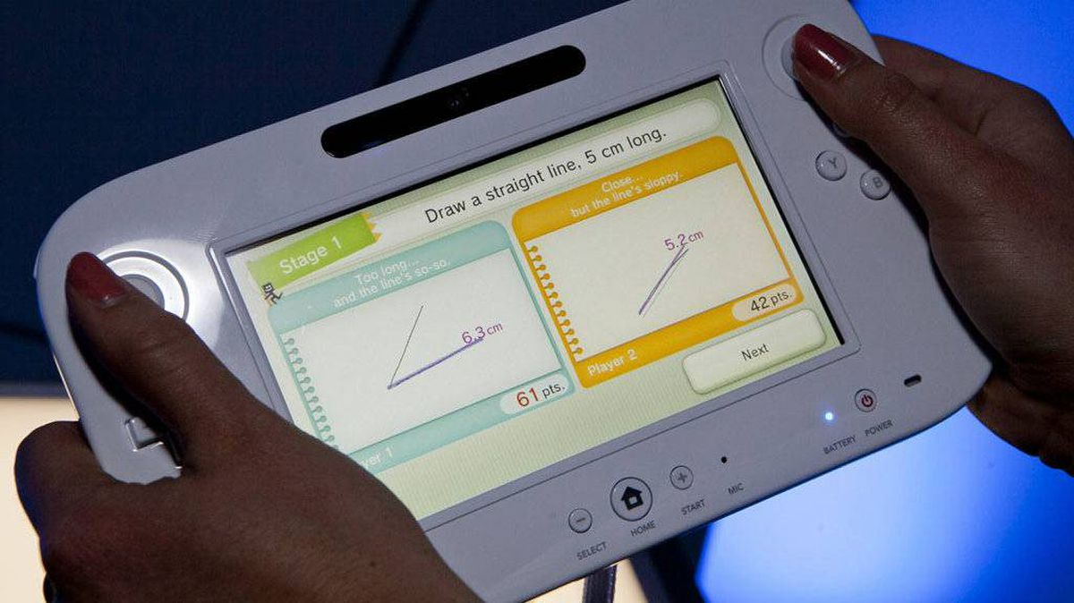 Nintendo's next video game console, the Wii U, is demostrated with the Measure Up game at the Nintendo booth at the 2011 Electronic Entertainment Expo in Los Angeles, Wednesday, June 8, 2011. The console will be put on sale in 2012.