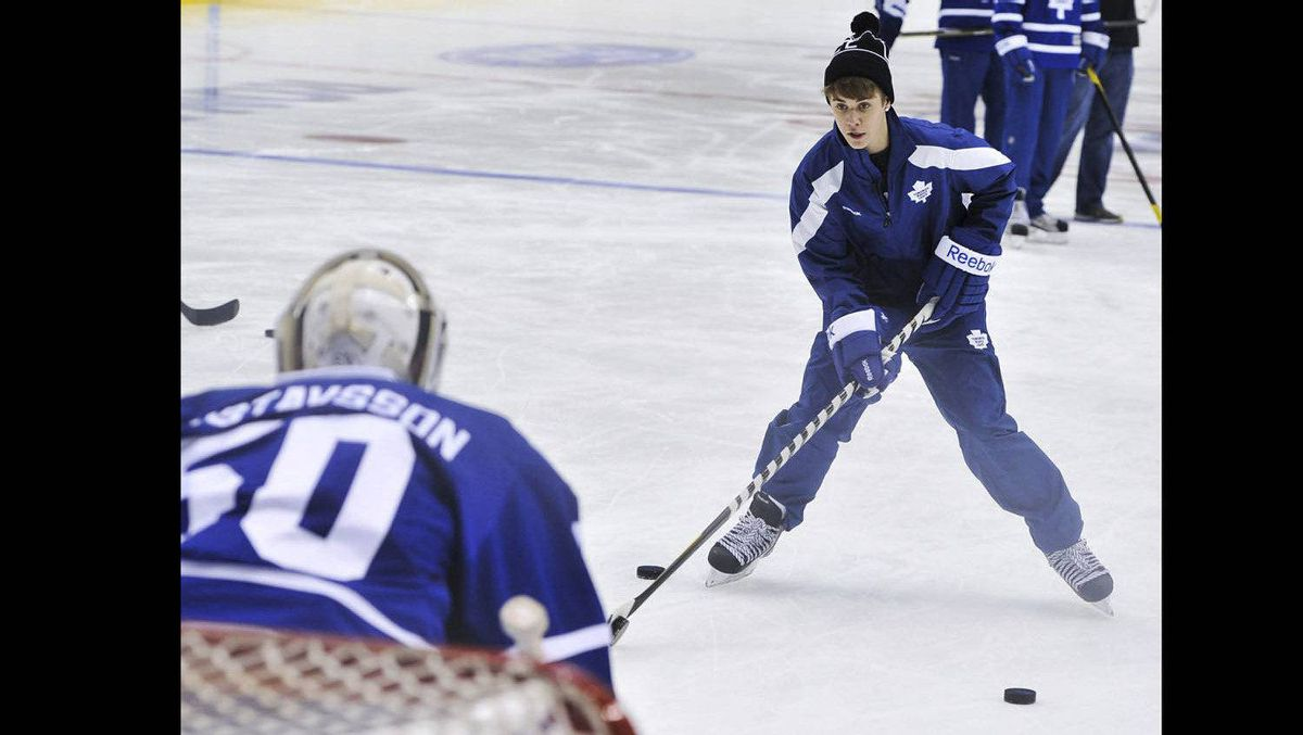 Justin Bieber takes a shot on Maple Leafs goalie Jonas Gustavsson on Dec. 21, 2011.