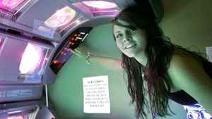 Rosie McDavid, 17, who has been using tanning beds since she was 14, prepares a tanning bed for a session, Wednesday, March 25, 2009, in Tallahassee, Fla. The Florida Legislature is considering a bill that would restrict tanning bed use by minors.