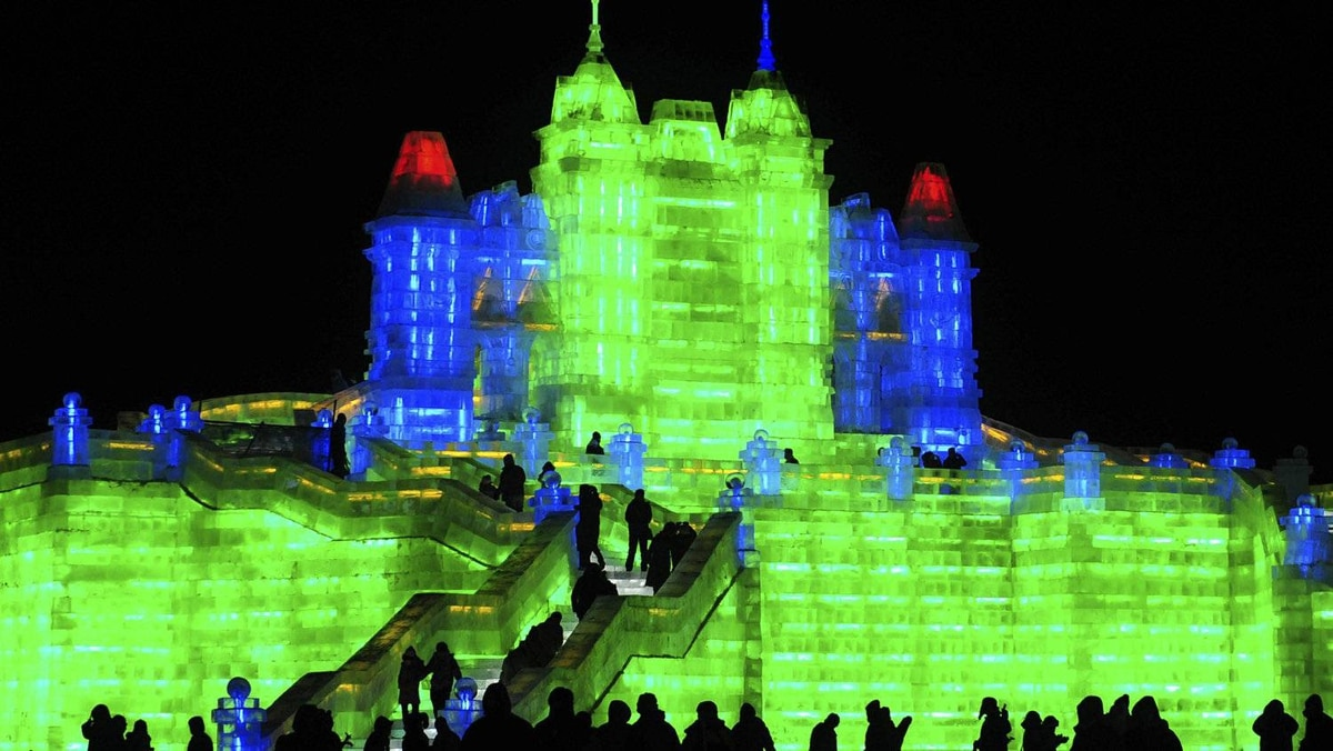 Tourists visit ice sculptures during the the lights testing period of the 13th Harbin Ice and Snow World in Harbin in China.