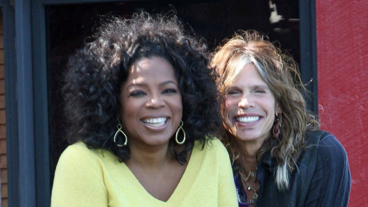 Oprah Winfrey and Steven Tyler of Aerosmith at Tyler's lakefront home in Lake Sunapee, N.H.