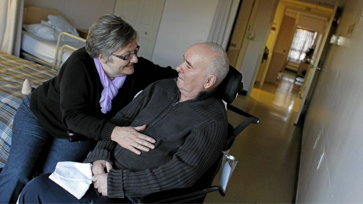 Jennifer Hall spends time with her husband Tom Hall , 61, as she does most afternoons, at Tyndall Nursing Home in Mississauga on Jan. 3, 2012.