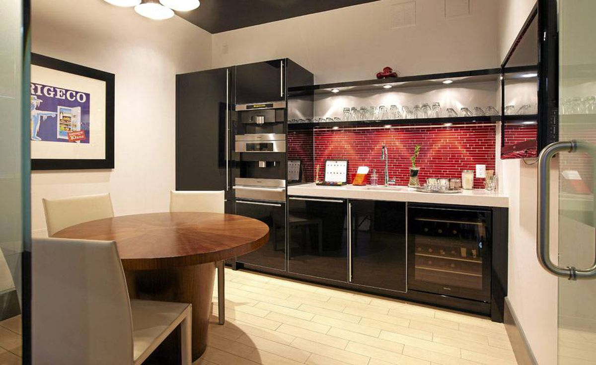 A vibrant red-tile backsplash fires up a kitchen setting in Toronto's Miele Caplans showroom (www.mielecaplans.ca).