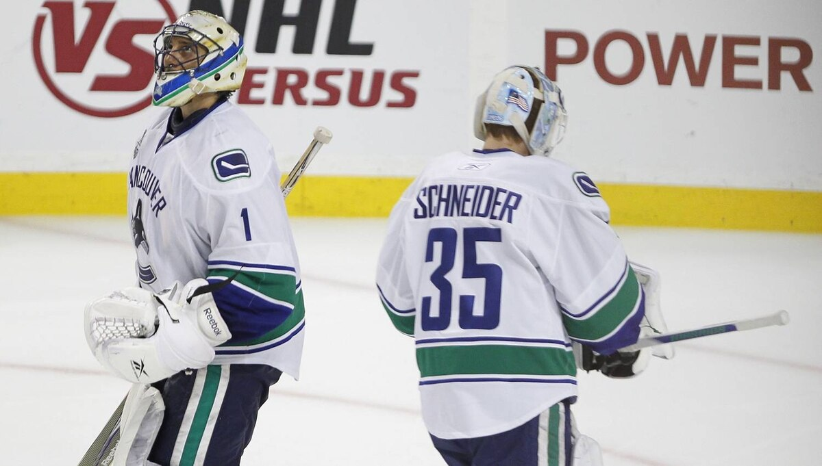 Vancouver Canucks goalie Roberto Luongo is pulled for Vancouver Canucks goalie Cory Schneiderduring the third period of Game 4 of the NHL Stanley Cup Final series between the Boston Bruins and the Vancouver Canucks in Boston on June 8, 2011. The Bruins won 4-0, with Boston Bruins Tim Thomas getting a shut-out and a slashing minor. (Photo by Peter Power/The Globe and Mail)
