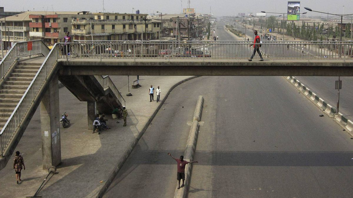 The ever-busy district of Oshodi in Lagos, Nigeria is deserted during a protest following the removal of a fuel subsidy by the Government Monday, Jan. 9, 2012. A national strike paralyzed much of Nigeria on Monday, with more than 10,000 demonstrators swarming its commercial capital to protest soaring fuel prices and decades of government corruption in the oil-rich country.
