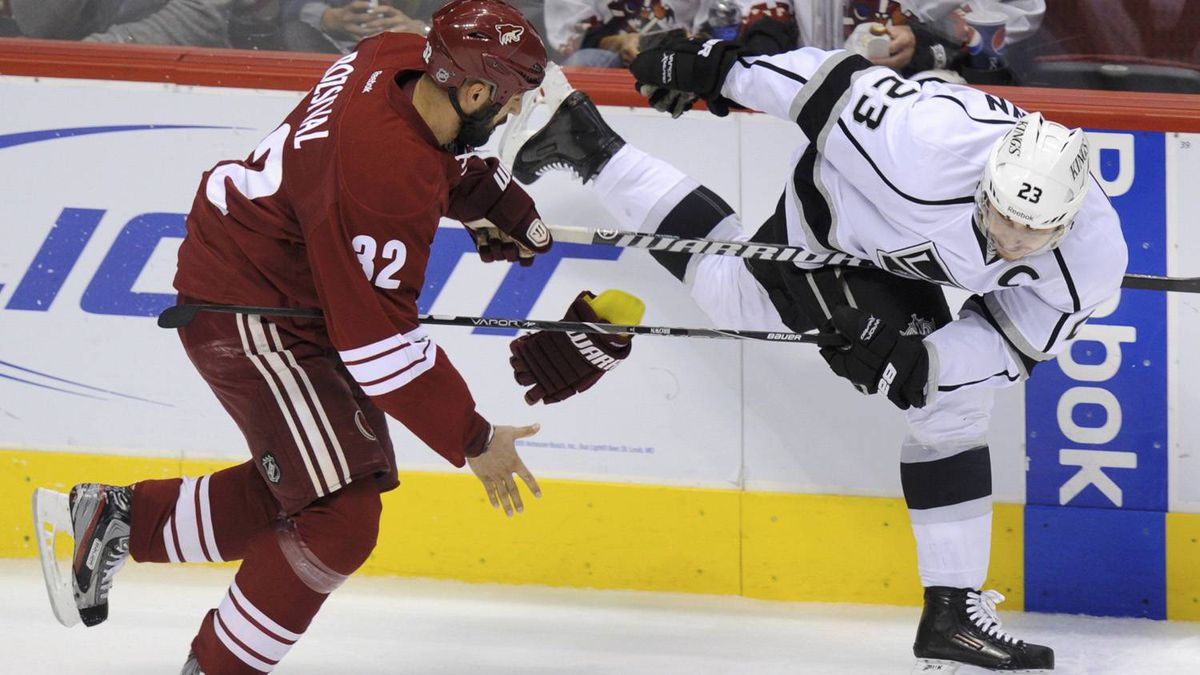 Phoenix Coyotes defenseman Michal Rozsival (32) loses his glove as he checks Los Angeles Kings right wing Dustin Brown (23) in the 1st period during Game 5 of the NHL Western Conference hockey finals in Glendale, Arizona, May 22, 2012. REUTERS/Todd Korol