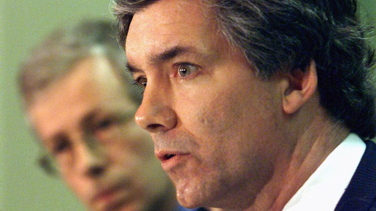 Bloc MP Daniel Turp speaks to reporters as his Liberal colleague Stephane Dion looks on in Montreal on March 23, 2000.