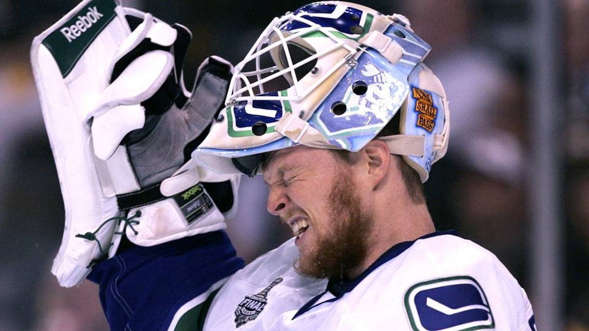 Vancouver Canucks goalie Cory Schneider adjusts his mask in the second period.