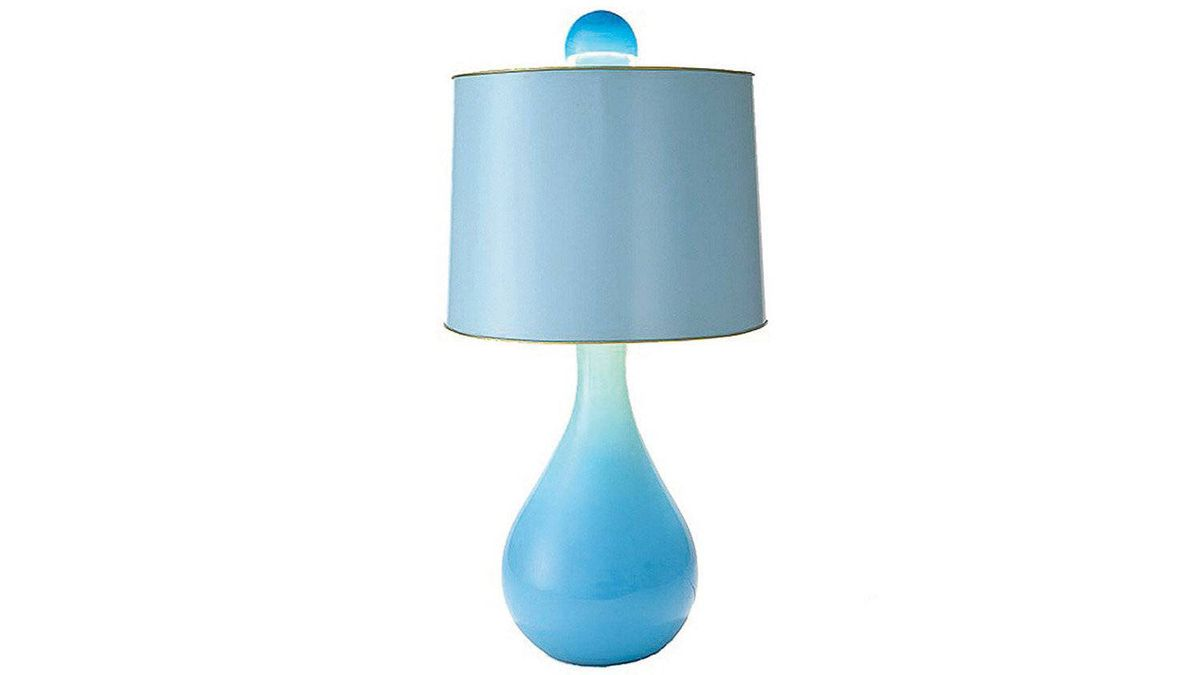 Created by Jane Gray for Stray Dog Designs, the Clare lamp's base is made of hand-blown recycled glass, as are its finials. The shades are hand-painted sheets of tin. $325 through www.straydogdesigns.com.