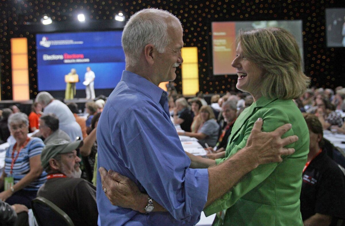 Leader Jack Layton congratulates former MP Peggy Nash on being elected New Democratic Party president at the national convention in Halifax.