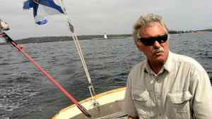 Peter Underwood in his classic Roue sloop off the coast of Nova Scotia.