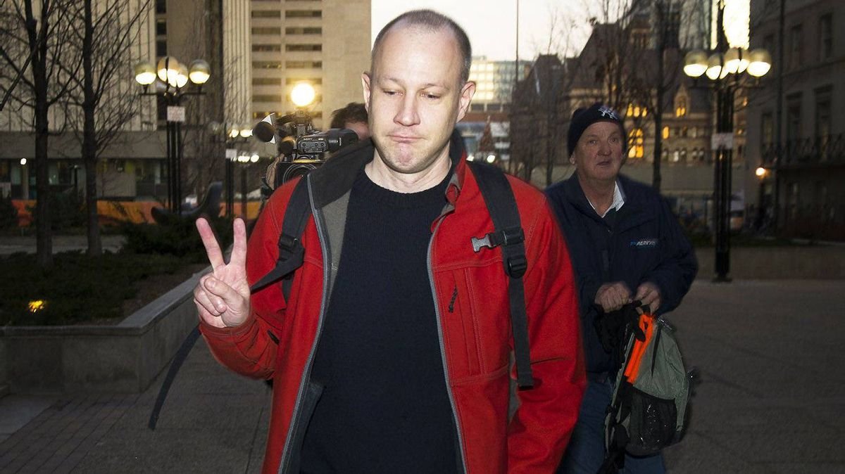 Byron Sonne, 39, who's trial began Monday, leaves the courthouse in Toronto. Police allege he assembled homemade explosives and incited others to tear down the G20 security fence and surveillance cameras through his Twitter and Flickr accounts.