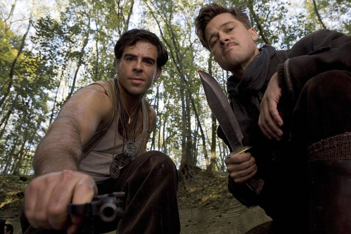 Eli Roth (left) and Brad Pitt are part of a lethal unit of Jewish commandos who beat Nazis with baseball bats, then take their scalps.