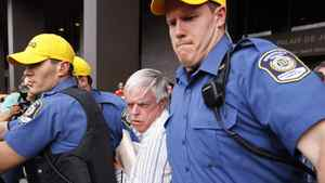 Earl Jones is rushed out of the courthouse in Montreal, July 28, 2009.