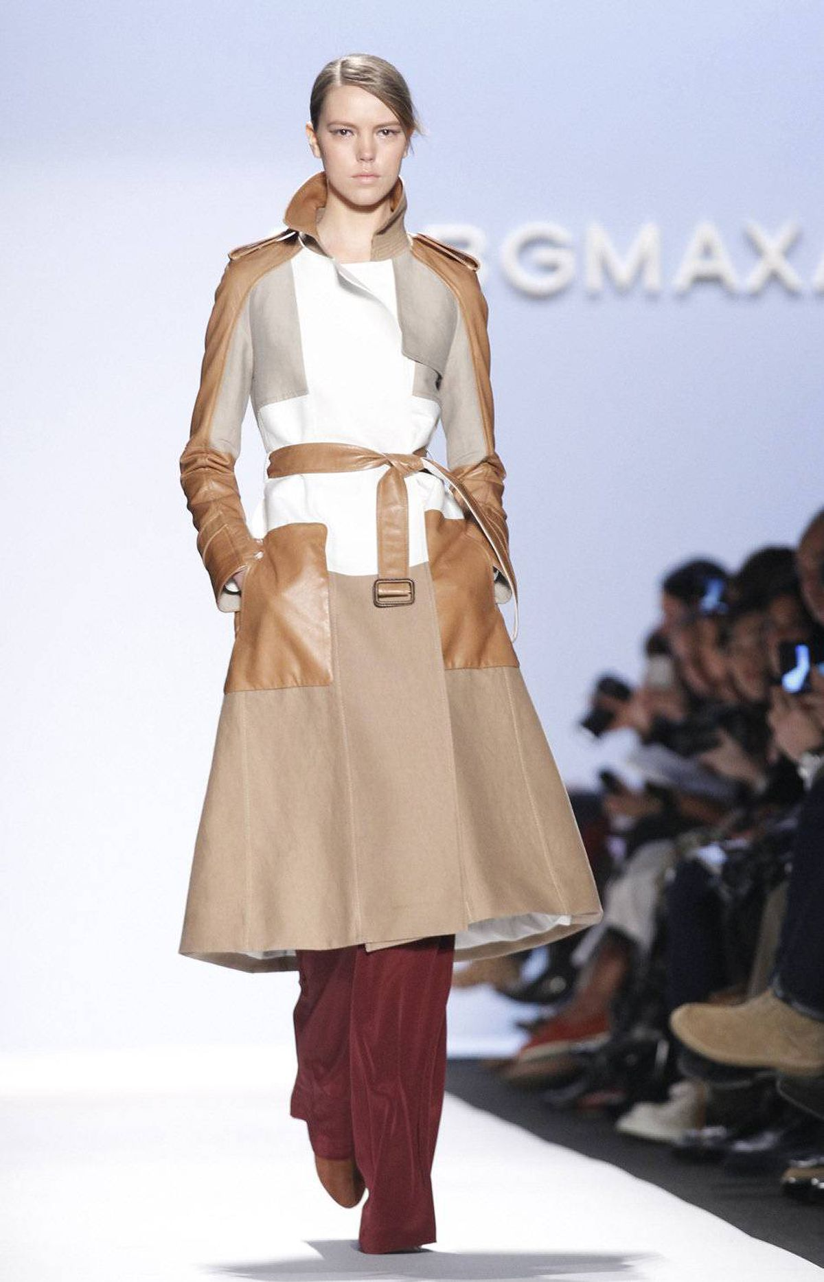 There were some sharp designs, such as this belted trench coat in canvas and leather. Note the wide-leg pants in deep burgundy, an early contender for next fall's hot hue.