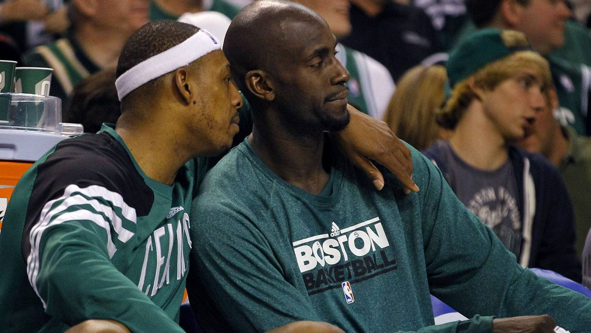 Boston Celtics forwards Paul Pierce (L) and Kevin Garnett talk on the bench during the fourth quarter of Game 5 of their NBA Eastern Conference playoff series against the Philadelphia 76ers in Boston, Massachusetts May 21, 2012. REUTERS/Brian Snyder