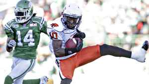 BC Lions wide receiver Kierrie Johnson catches the ball before being taken down by Saskatchewan Roughriders safety James Patrick during first half CFL football game in Regina, Saskatchewan October 16, 2011. REUTERS/David Stobbe