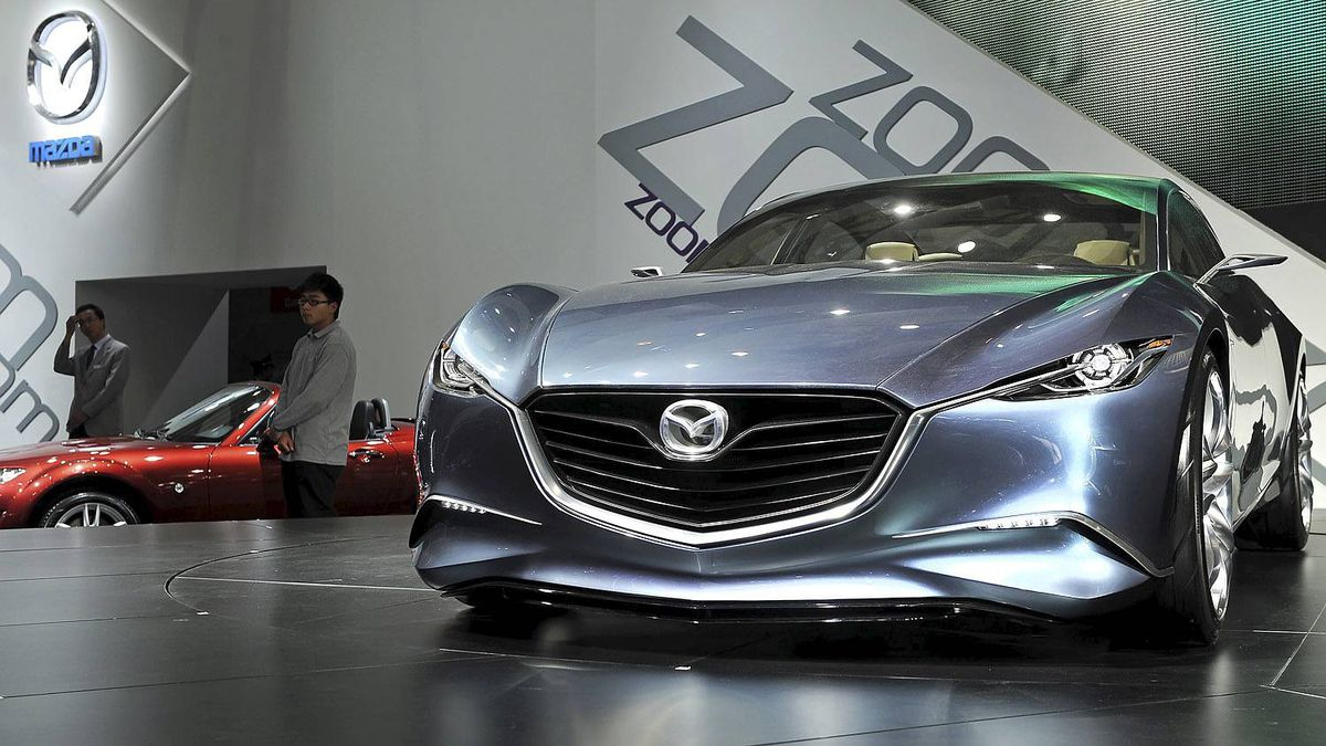 "The Mazda ""Shinari"" concept car is displayed at the Shanghai Auto Show in Shanghai on April 19, 2011. About 2,000 car and parts makers from 20 countries are participating in the Shanghai auto show, showcasing 75 new car models, 19 of them making their world premieres. AFP PHOTO/Philippe Lopez (Photo credit should read PHILIPPE LOPEZ/AFP/Getty Images)"
