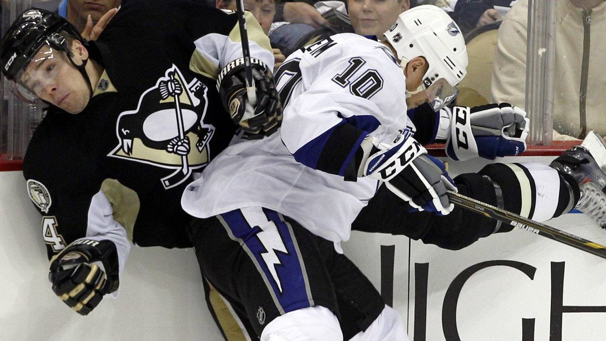Tampa Bay Lightning's Sean Bergenheim (10 ) checks Pittsburgh Penguins Zbynek Michalek (4) into the boards. REUTERS/ Jason Cohn