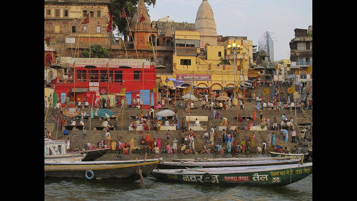 Lynn Muscat photo: Morning Routine - The Ganga river that runs through India is considered to be the holiest of rivers by Hindus. Every morning in Varanasi, people flock to the river's edge to bathe, wash clothes, swim and pray.