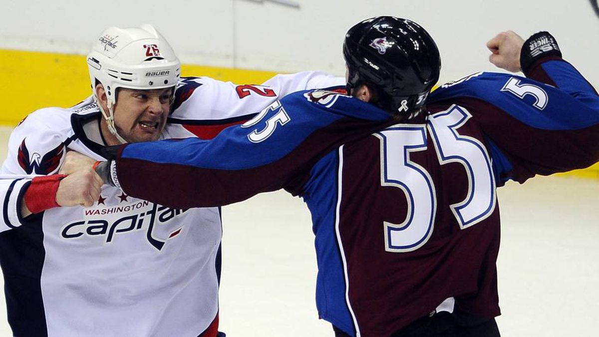 Colorado Avalanche left wing Cody McLeod (55) and Washington Capitals left wing Matt Hendricks (26) fight in the first period of the game at the Pepsi Center.