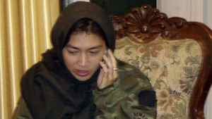 Canadian journalist Mellissa Fung speaks on her phone after being released in Kabul Nov. 8, 2008.