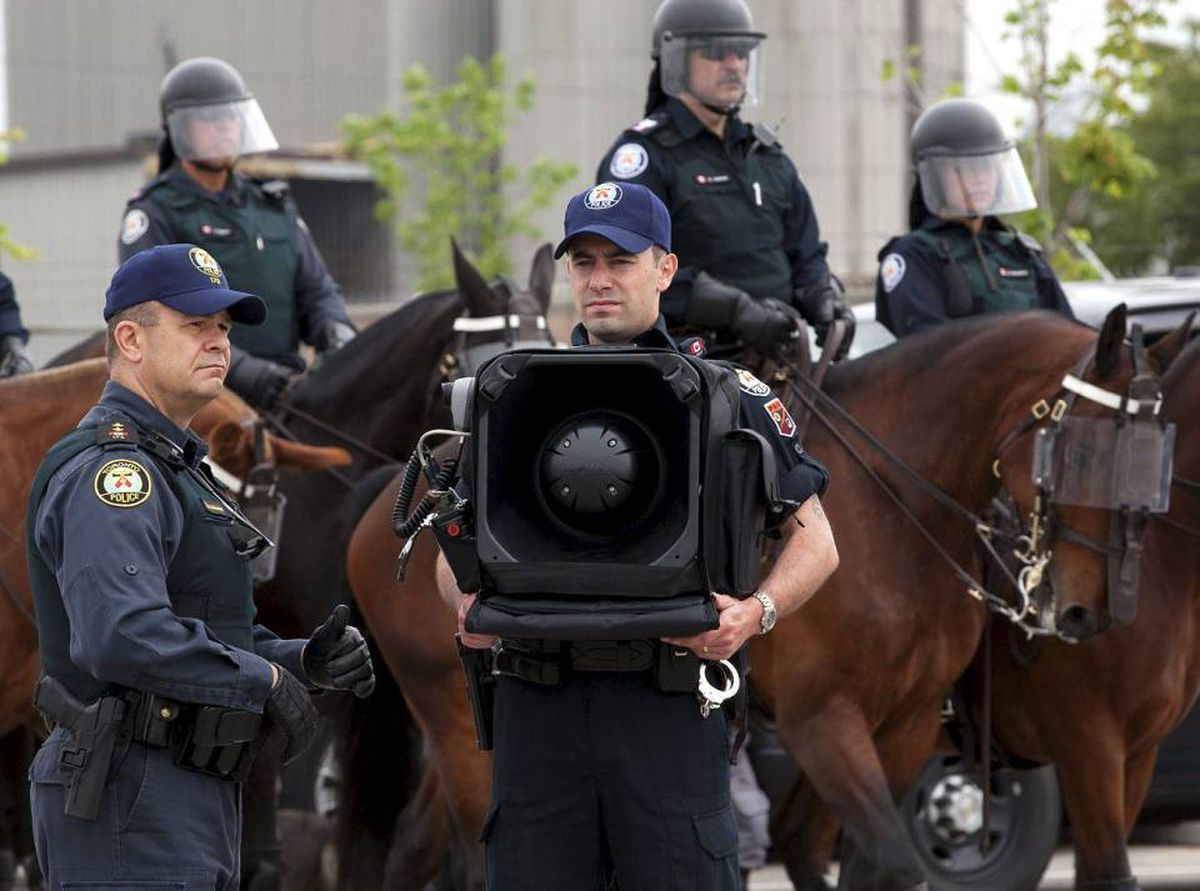 A police officer stands by with and LRAD-X 100 Acoustic Communication Device (sound cannon) during a demonstration of G20 security and crowd control measures in Toronto on Thursday June 3, 2010.