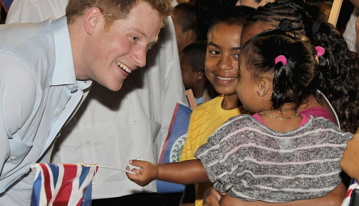 "Prince Harry goes on a walkabout at a ""block party"" in the newly named Queen Elizabeth II Boulevard, in the capital city of Belmopan, Belize, on March 2, 2012. The Prince is on a Diamond Jubilee tour where he is visiting Belize, the Bahamas, Jamaica and Brazil as a representative of the Queen."
