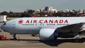 An Air Canada Boeing 777 taxis at Sydney airport after being given the all clear to resume its journey to Vancouver July 28, 2011.