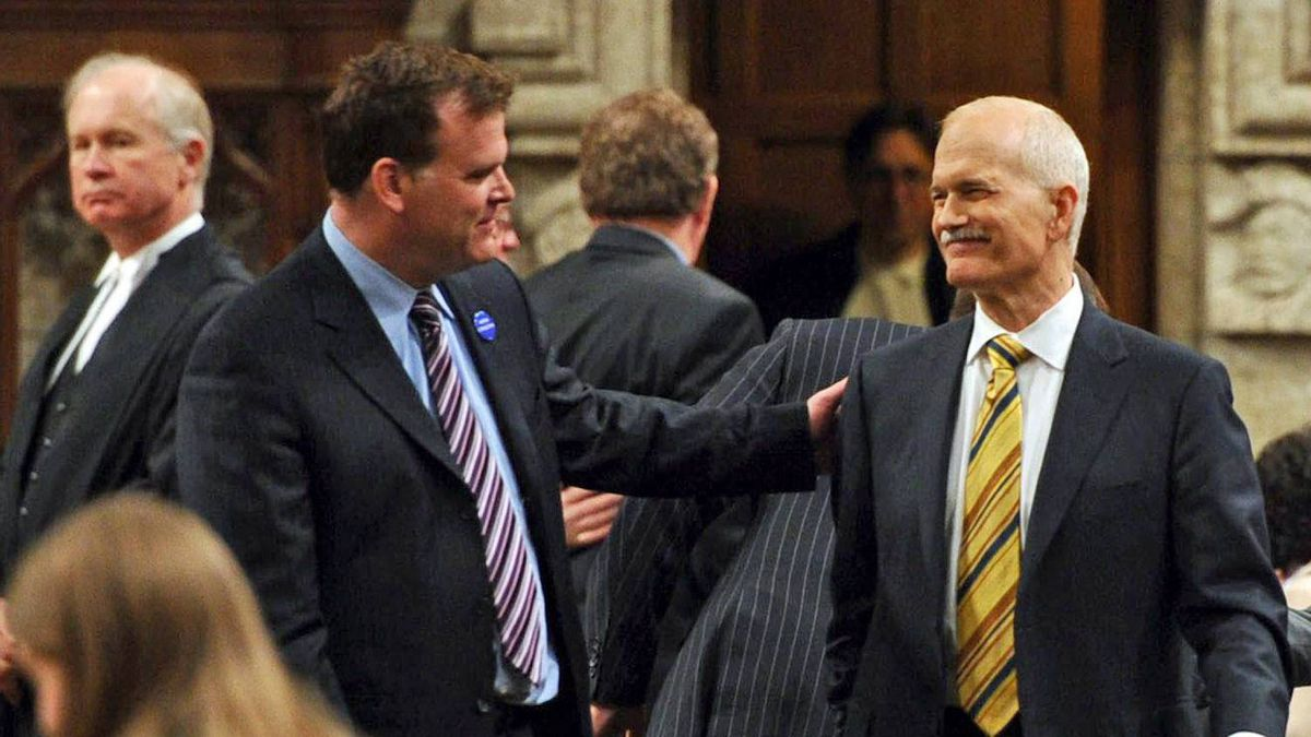Foreign Affairs Minister John Baird and Opposition Leader Jack Layton share a moment in the House of Commons as it resumes on June 2, 2011.