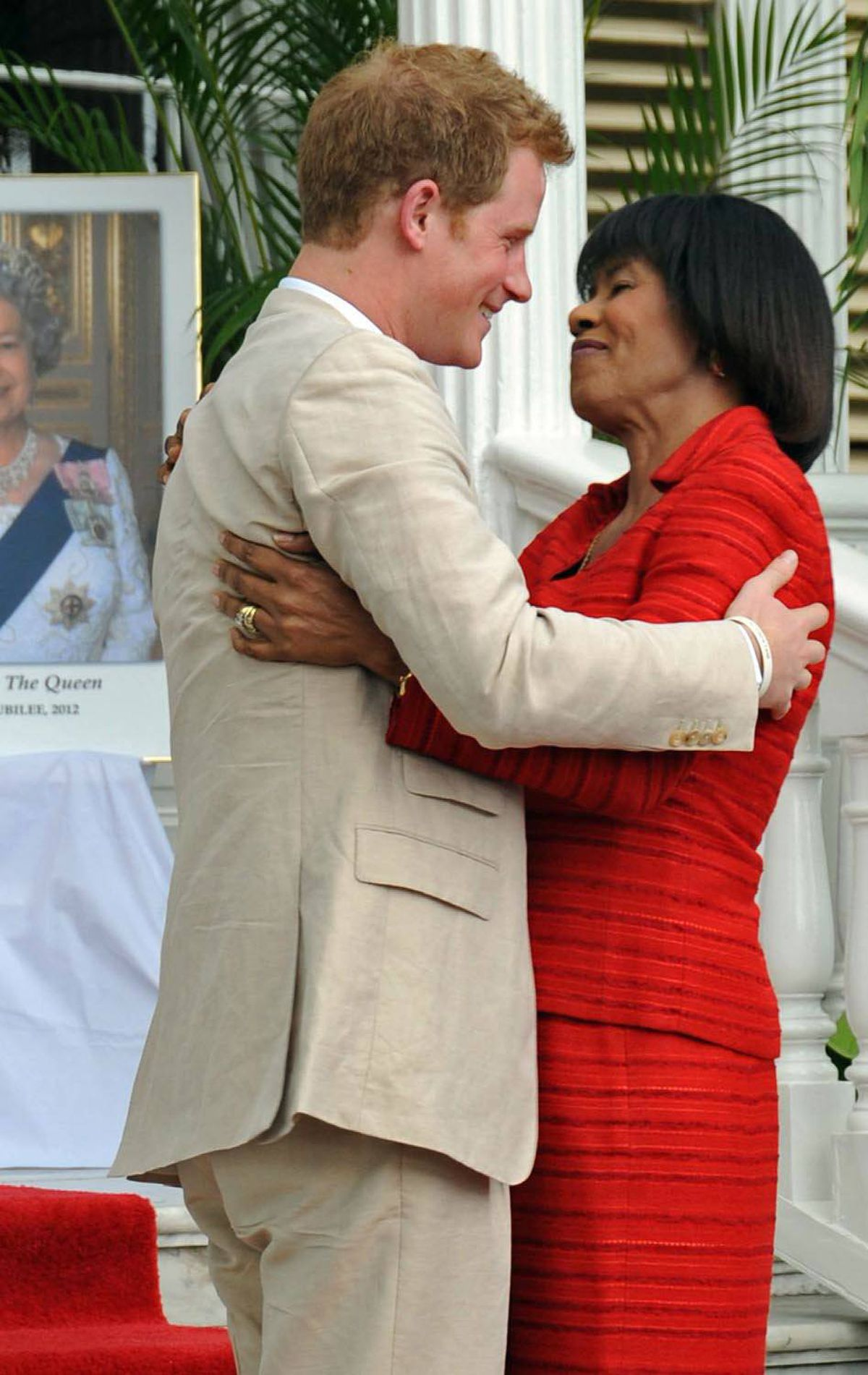 DIPLOMAT Britain's Prince Harry is welcomed by Jamaica's Prime Minister Portia Simpson Miller to a lunch in Kingston, Jamaica, Tuesday March 6, 2012.