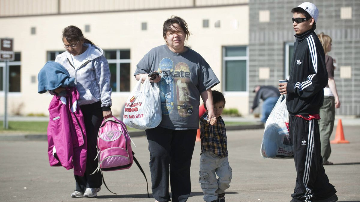 Evacuees from the town of Slave Lake, Alberta, arrive at the Athabasca, Alta. community Sportplex on Tuesday, May 17, 2011.
