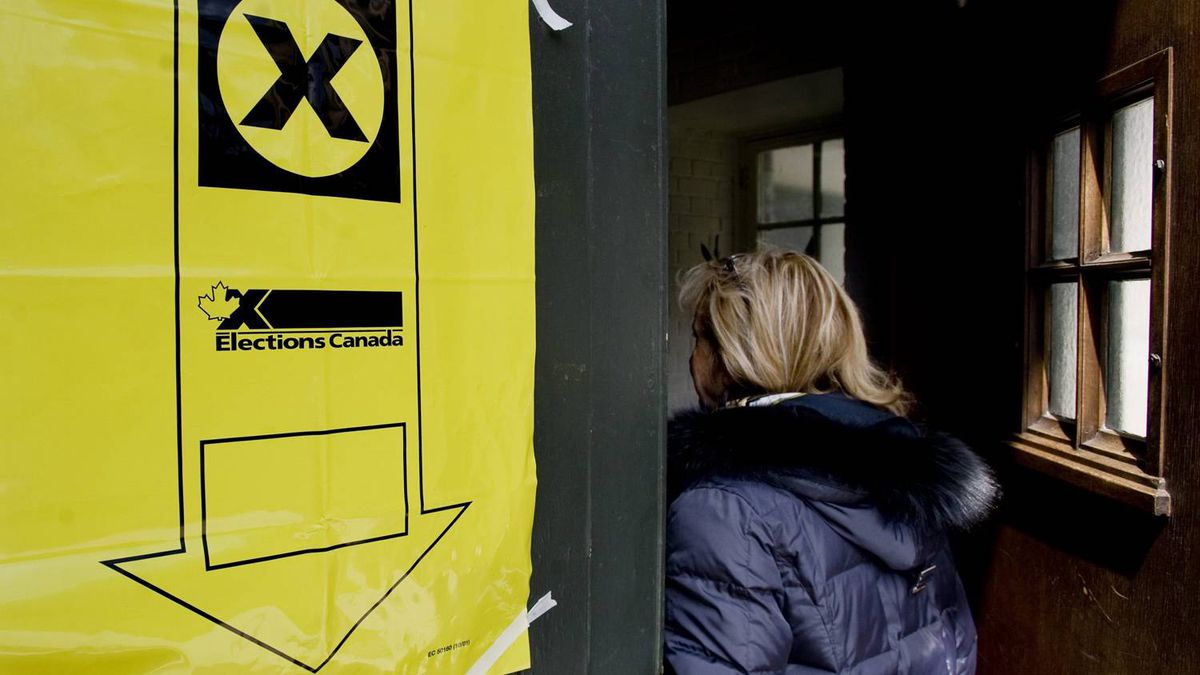 A woman enters an advanced polling station in Montreal Friday, April 22, 2011. Canadians will vote in a federal election on May 2, 2011.