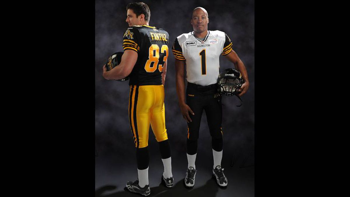 Hamilton Tiger-Cats Andy Fantuz and Henry Burris model the team's new jerseys.