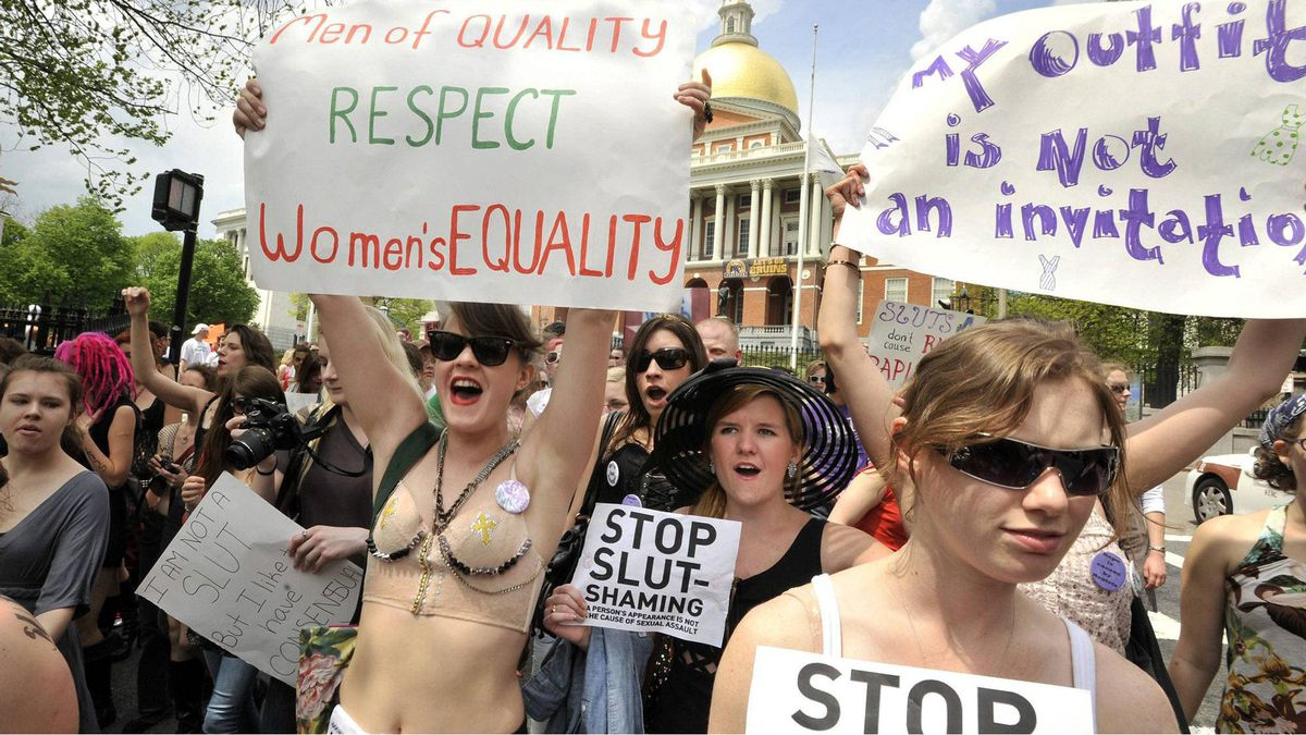 Women march past the Statehouse during the SlutWalk in Boston, Saturday, May 7, 2011.