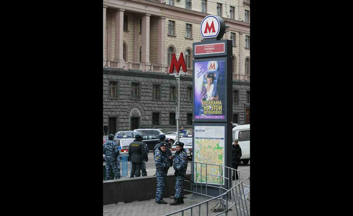 Russian policemen are seen in front of the Lubyanka metro station entrance.