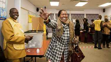 Kitchener woman Roda William Gany, 30, celebrates after casting her vote for the Southern Sudan referendum. Voters flock to a polling station in North York, Jan. 9, 2010 to cast their ballots for a referendum in Southern Sudan on whether or not the region should remain a part of Sudan.