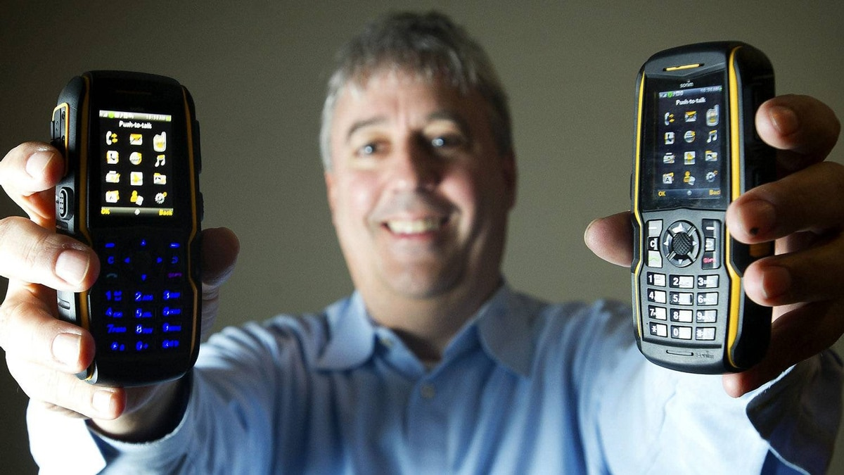 """""""No typing an e-mail. It's just push a button, and boom, you're through."""" Bell Mobility president Wade Oosterman with the company's new """"push-to-talk"""" phones in Toronto, Monday, April 9, 2012."""