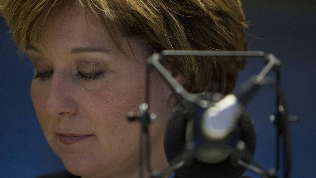 British Columbia Premier Christy Clark pauses for a moment as she takes part in a local radio program in downtown Vancouver, Monday, Feb. 13, 2012.