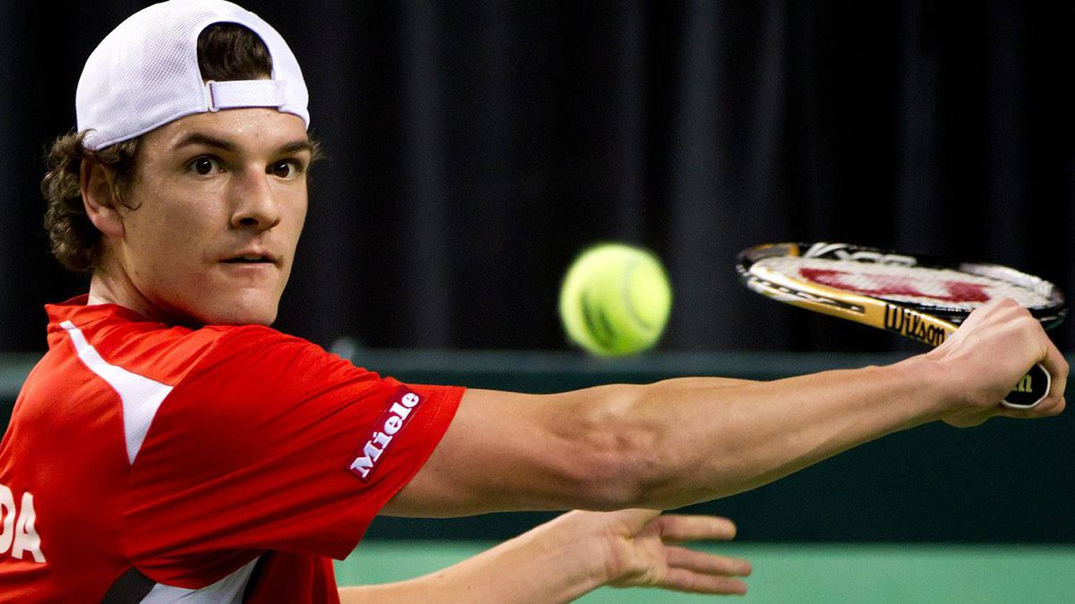 Canada's Frank Dancevic returns to France's Jo-Wilfried Tsonga during the first set of a Davis Cup tennis singles match in Vancouver, B.C., on Sunday February 12, 2012. THE CANADIAN PRESS/Darryl Dyck