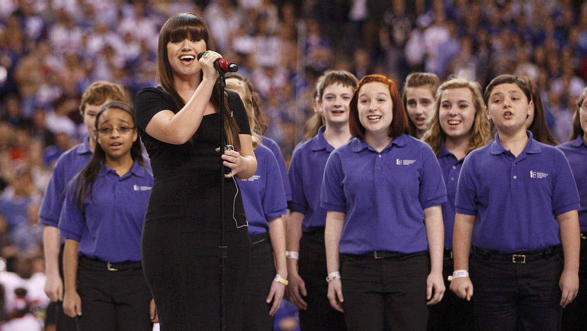 Kelly Clarkson sings the national anthem before the start of the NFL Super Bowl.