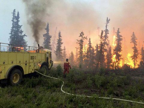 Thousands flee wildfires raging across Western Canada