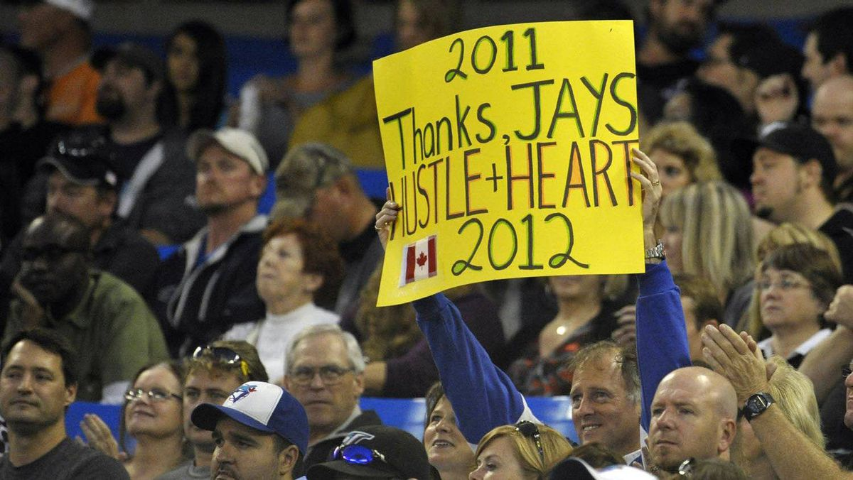 A Toronto Blue Jays fan holds up a sign thanking the players during the team's last home game of the season against the Los Angeles Angels on Sept. 22, 2011.