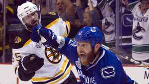 Vancouver Canucks left wing Raffi Torres celebrates after scoring the winning goal as Boston Bruins defenseman Johnny Boychuk looks on during the third period of Game 1 in the Stanley Cup final in Vancouver, Wednesday, June 1, 2011.