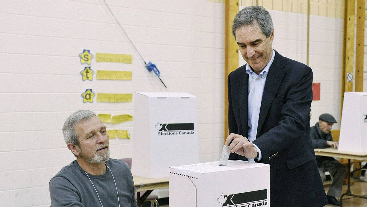 Liberal leader Michael Ignatieff, right, places his vote at an certified election Canada polling station in Etobicoke, Ont., on Monday, May 2, 2011.