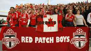 """Toronto FC fan club """"Red Patch Boys"""" members cheer on their team during a game against New York at BMO field in Toronto, June 6, 2007."""