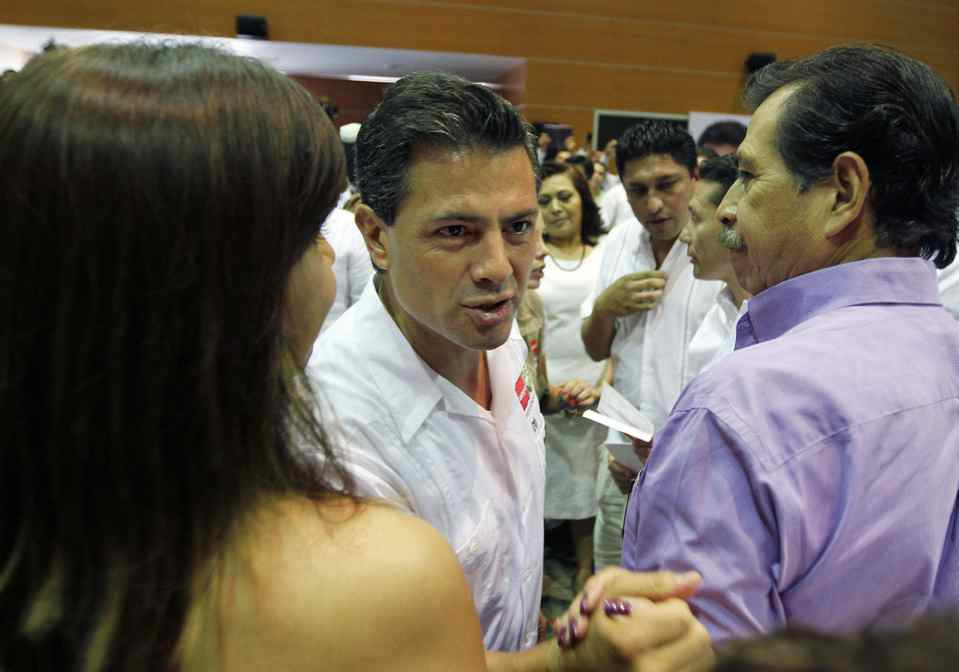 Enrique Pena Nieto, Mexican presidential candidate for the Institutional Revolutionary Party (PRI), greets supporters at a campaign stop in the oil city of Ciudad del Carmen, Campeche state on May 16, 2012.